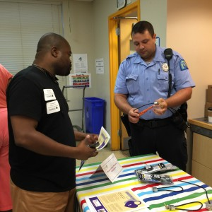 Officer Berkley of the St. Louis Metropolitan Police Department demonstrates various way to use the lock
