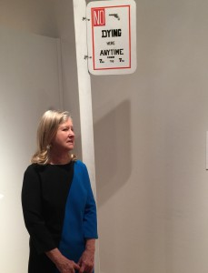 "Nancy Galofre in front of ""No Dying Here"" sign"